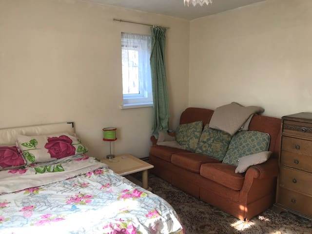 Large room, dbl bed, wardrobes, tv, fridge, sofa