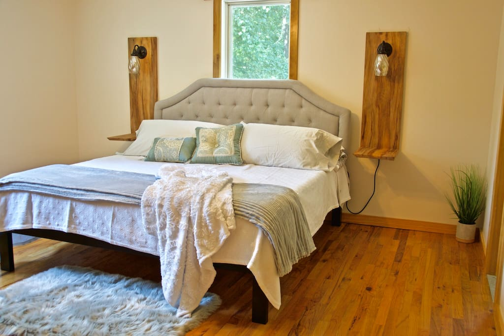 King-sized bed in master bedroom with new memory foam mattress.