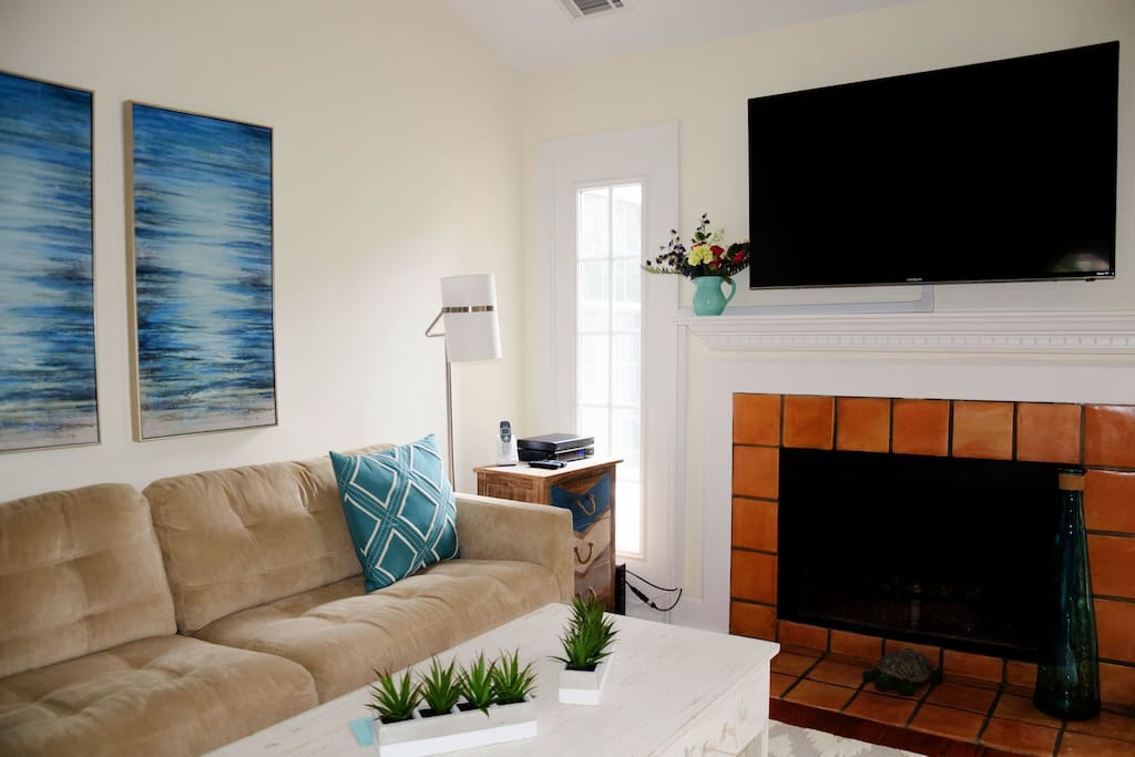 The living room is very inviting and comfortable furnishings, with a  new large flat screen over the fireplace.