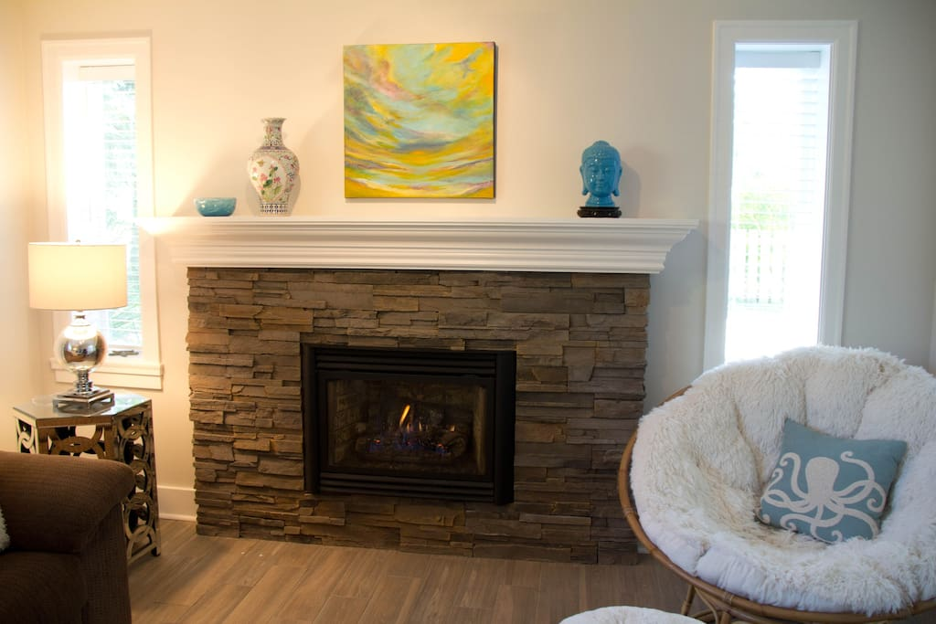 The living room has a gas fireplace and the most comfortable papasan chair!