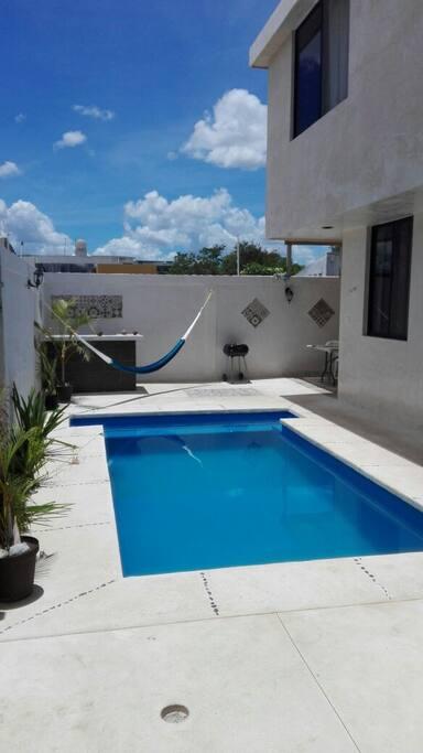 zona común con piscina