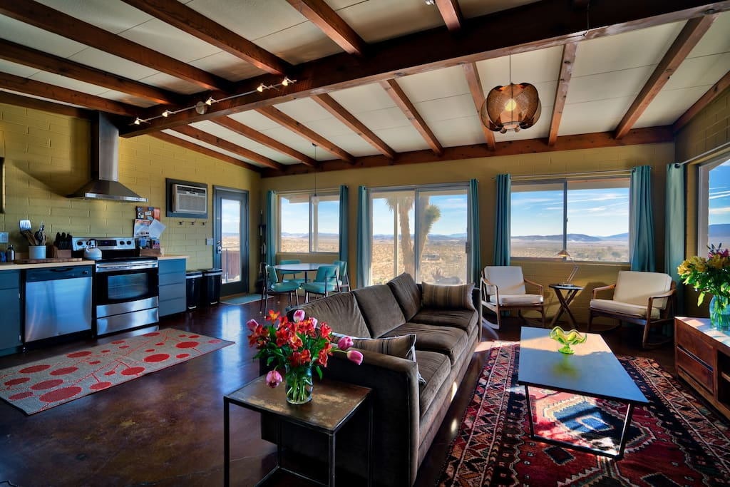 Livingroom/kitchen with lots of windows to take in the views