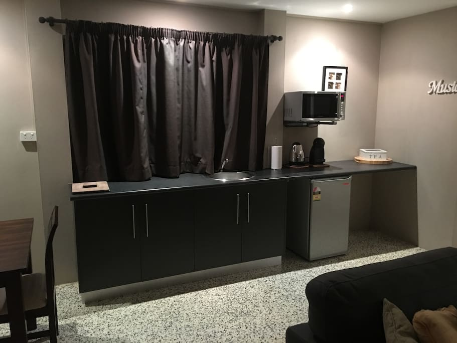 Kitchenette with bar fridge and microwave