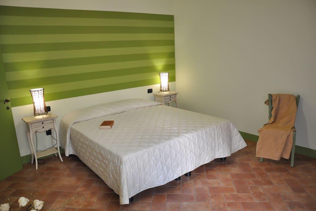 Camera composta da letto matrimoniale e terzo letto