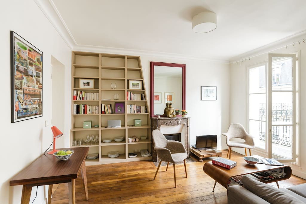 The view from the room: a small Swedish convertible dining table and a great library