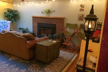 Living room has push button gas fireplace.