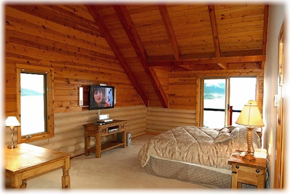 A master bedroom overlooking Howe Sound.