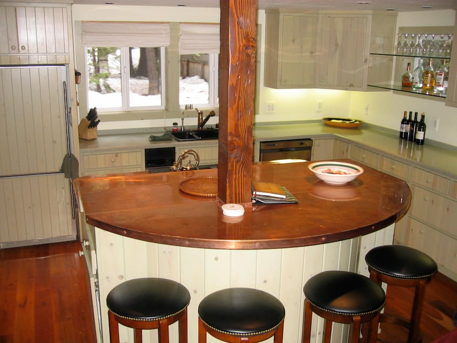 Kitchen with copper bar/island