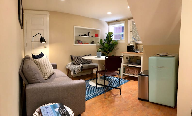 Relax in a cozy living space. There's now also a small microwave on top of the refrigerator!