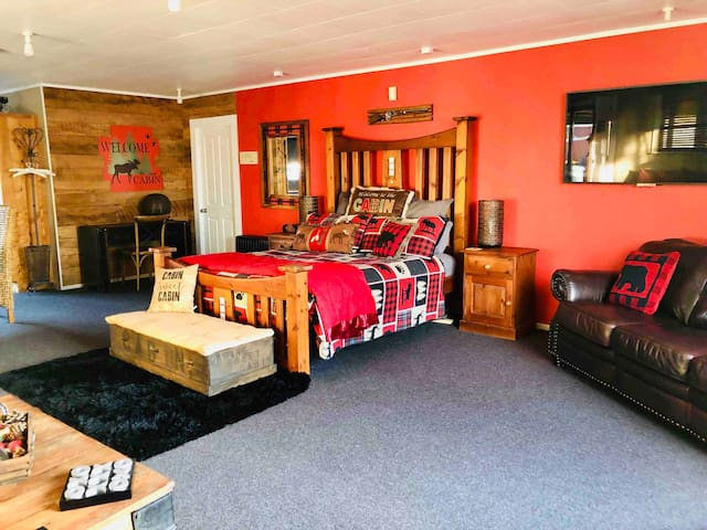 Bed and half of lounge area