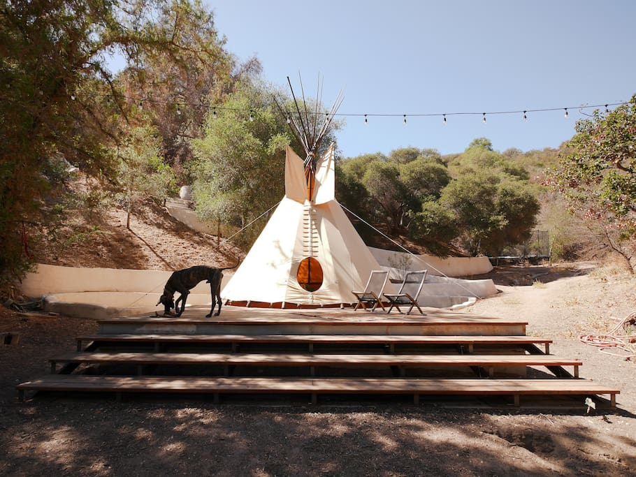 Behind the house is a 700 square foot deck with 20 foot diameter teepee - more pictures og inside and fire pit further on...