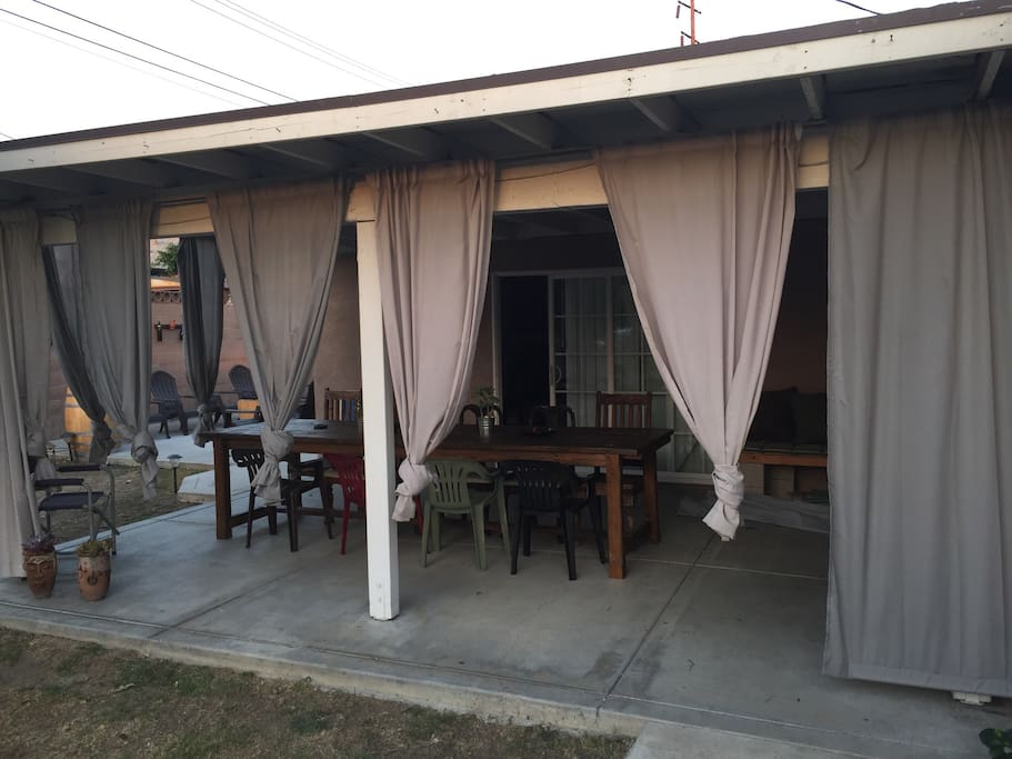 Large patio table perfect for dinner outdoors after a long day. Smoking outside is ok