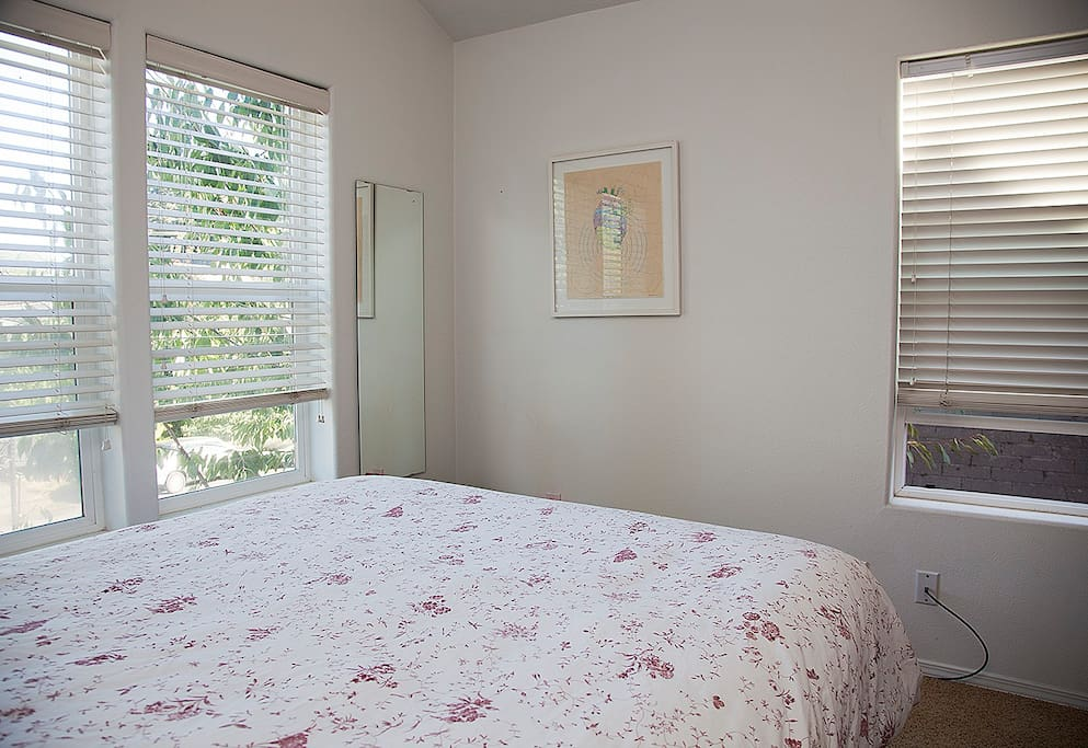 The private room has a very nice queen size firm plush mattress, night stand, reading lamp, writing desk, desk chair, desk lamp, luggage rack, closet, full-length dressing mirror, high ceiling and lots windows!