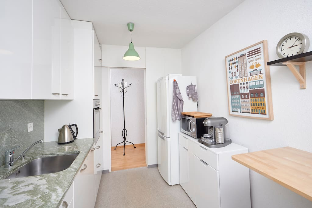 Kitchen with dishwasher, microwave, fridge, Nespresso coffee machine etc.