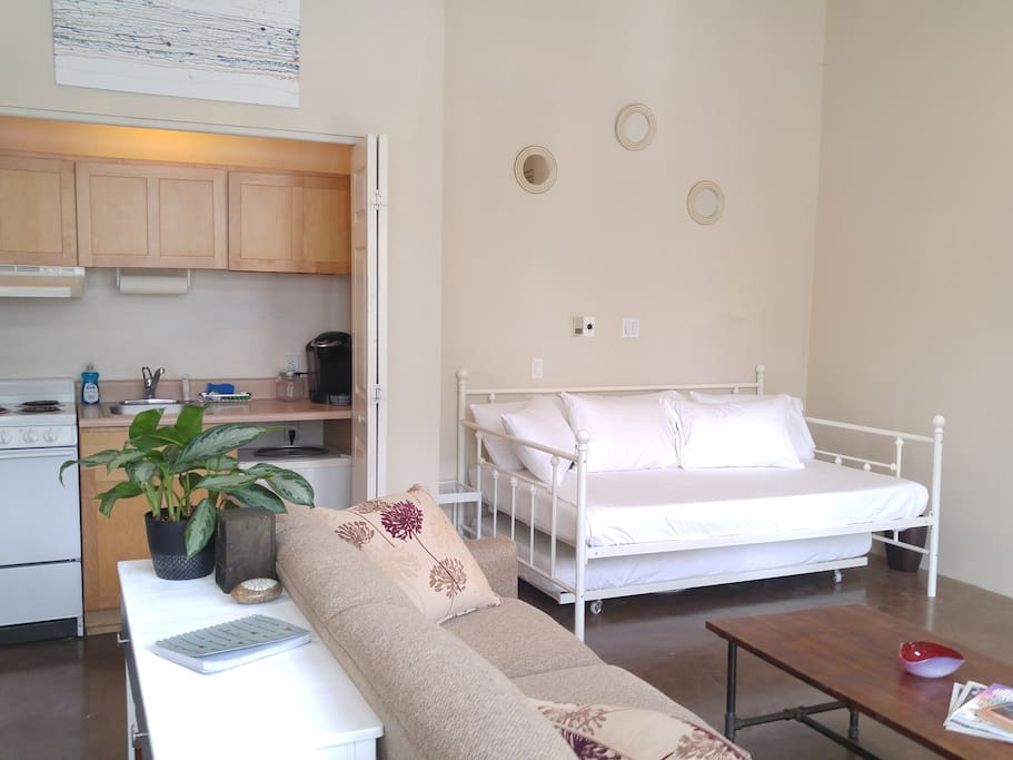 On the right of this photo, you can see the full-size daybed. There is also a twin-size trundle bed stored underneath it. Both are comfortable memory foam mattresses.