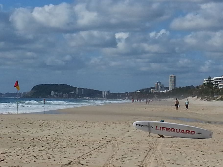 On the beach, Surfers Paradise in the distance.