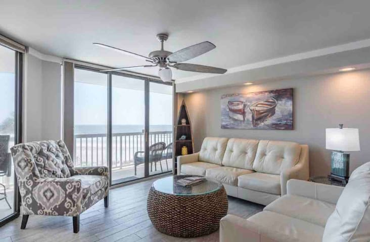 Large beach front condo with pool