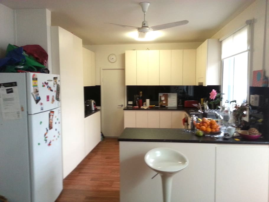Large Kitchen with plenty of bench space. Dining room