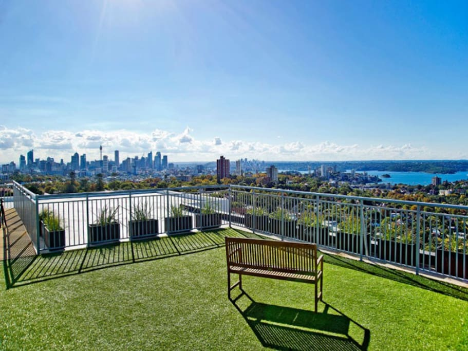 Communal rooftop with harbour and city views. Ideal for fireworks.