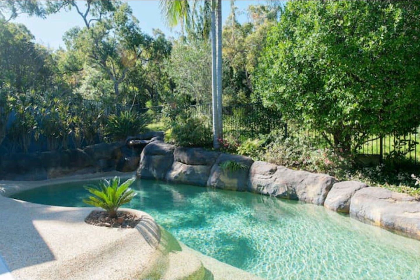 Salt water, solar heated resort style pool with waterfall. Available at all times for Poppy Magnolia guests.