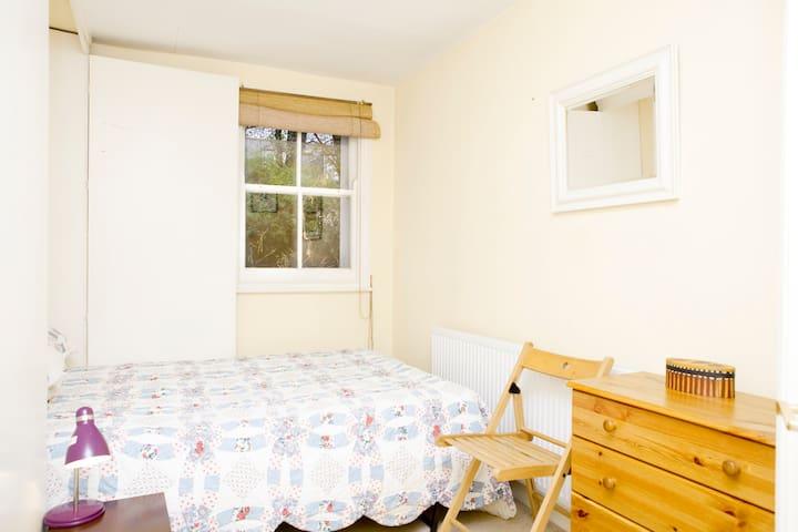 The garden bedroom overlooking the lovely sunny garden in the summer!