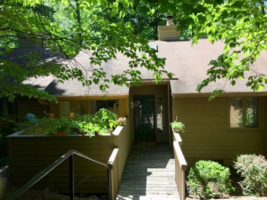 The townhouse is located in a wooded and secluded neighborhood. There is parking available right outside the home.
