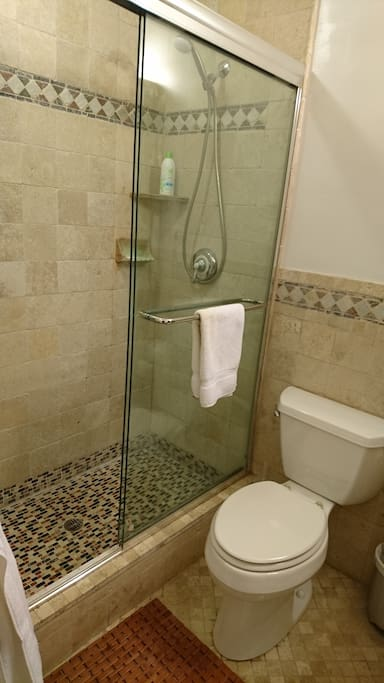 Large ceramic stand-up shower with sliding glass doors
