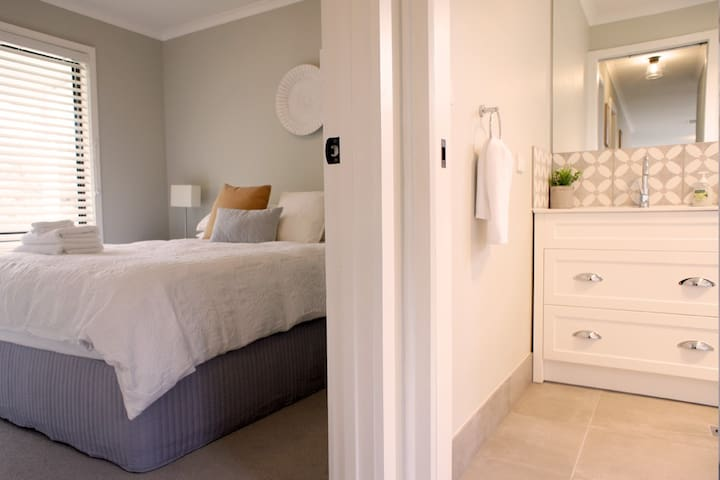 Hall way leading to bathroom and second bed room