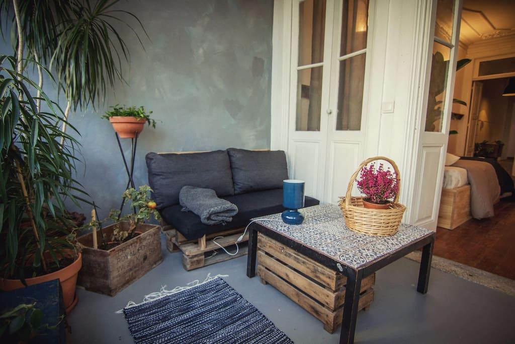 Cozy Veranda Winter Garden with Sofa and Coffee Table