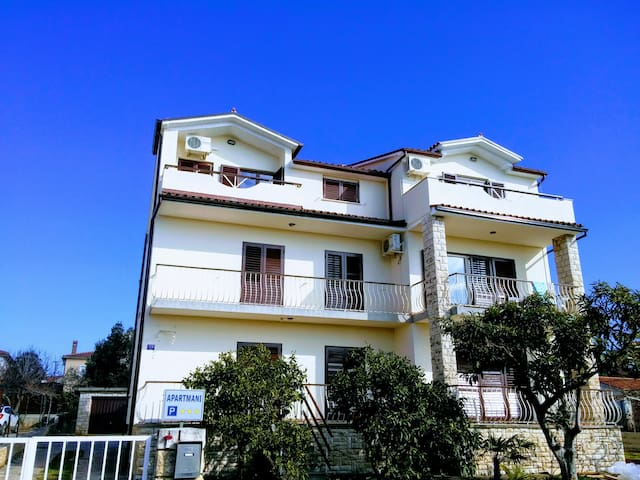 Frontal view of the house (apartment is on the top floor at the right)