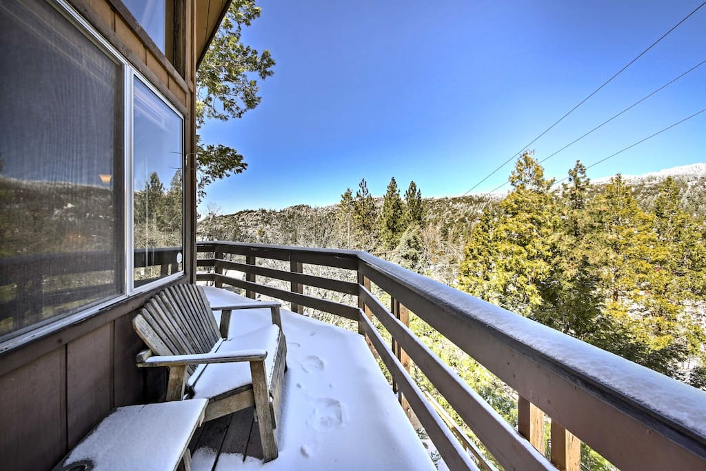 Scenic forest and mountain views will dazzle you from the wraparound deck.