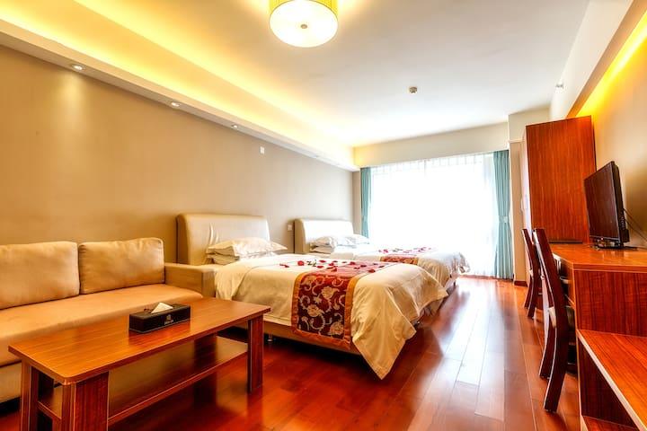 青岛深蓝假日度假式公寓--豪华家庭双床公寓 - Qingdao - Lägenhet
