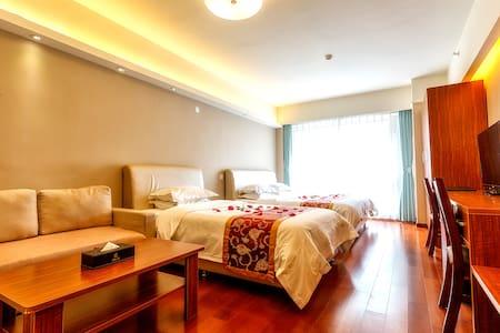 青岛深蓝假日度假式公寓--豪华家庭双床公寓 - Qingdao - Wohnung