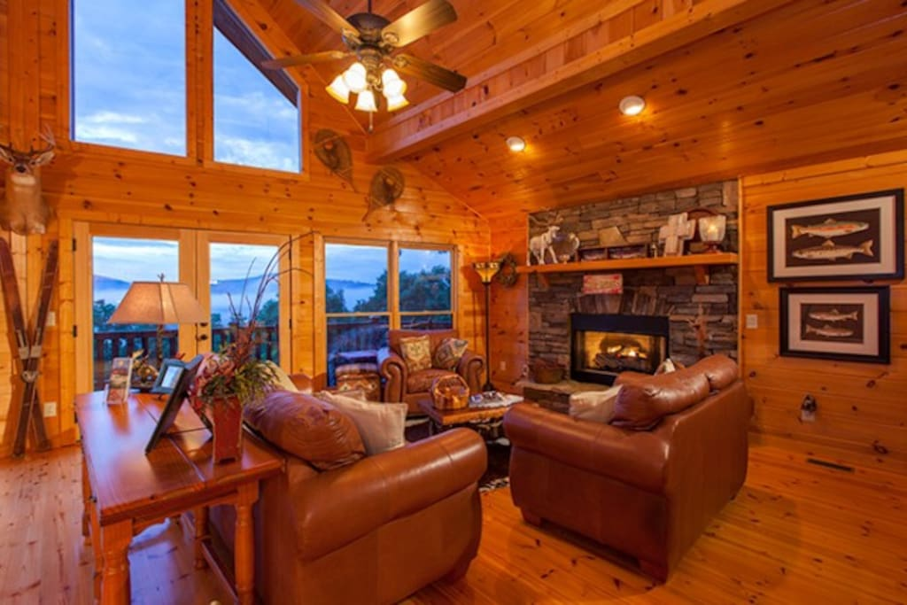 Living Area with a Beautiful Stone Fireplace and Luxurious Leather Furnishings