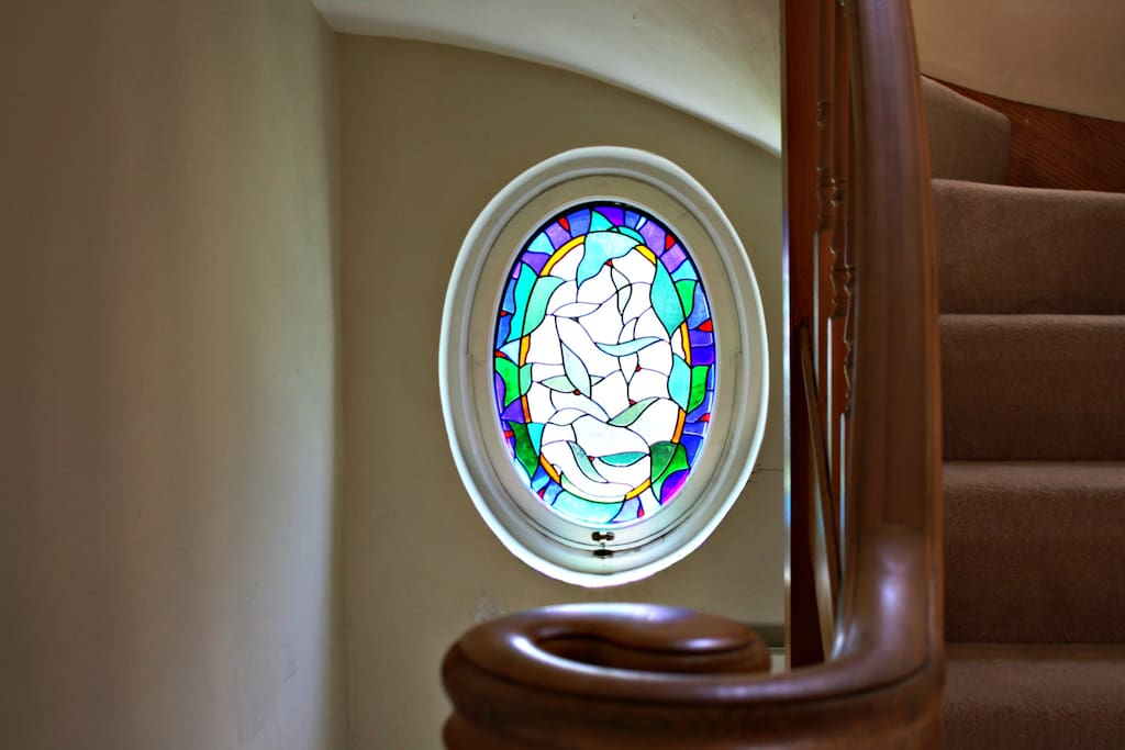 Hallway stained glass window that was made round the corner by Opus Glass Design