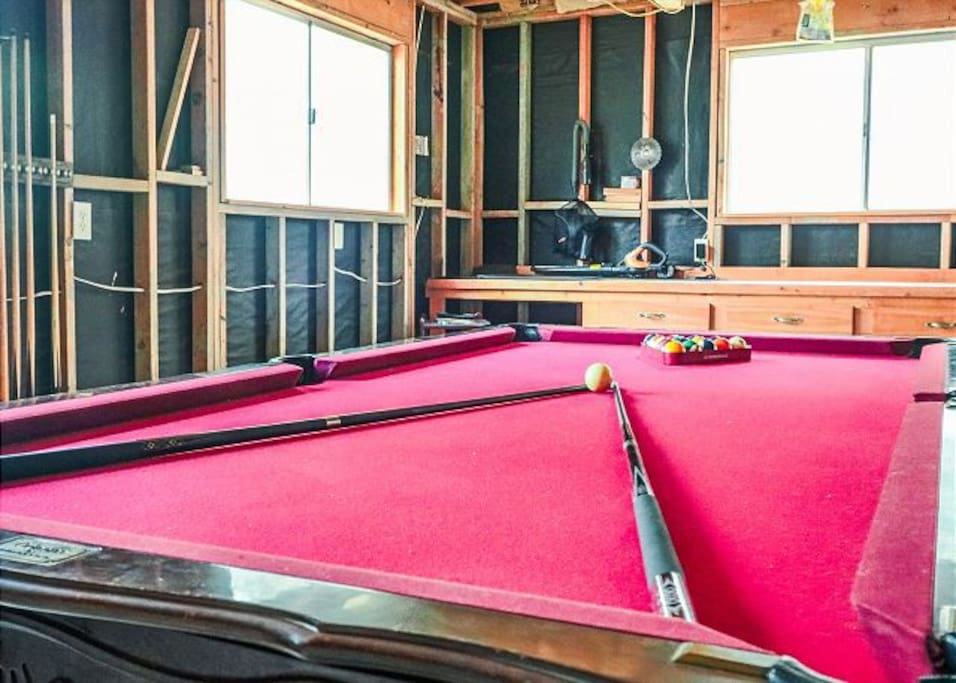 Home has a pool table in the game room.