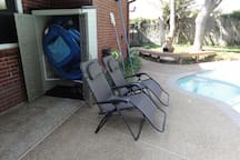 Nicely shaded reclining chairs pool side, as well as floating pool chairs in the shed, and bench seating near the hot tub.