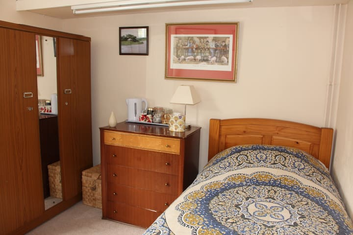 One Bedroom Room with desk and chest of drawers