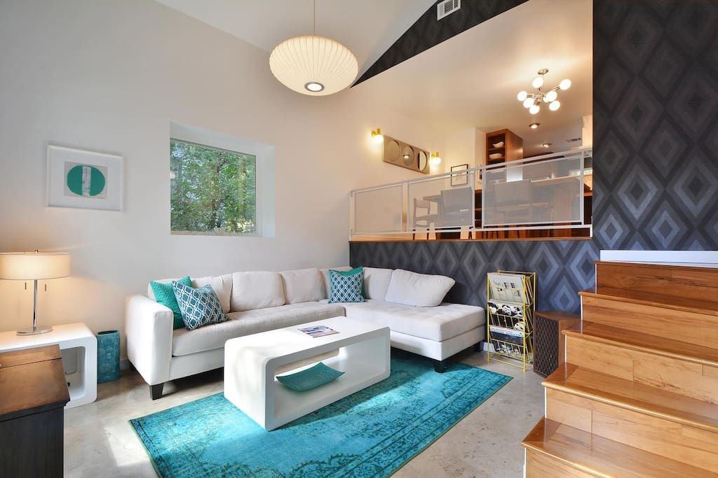 Relax on the super comfortable and inviting sofa in the 50's style sunken living area.