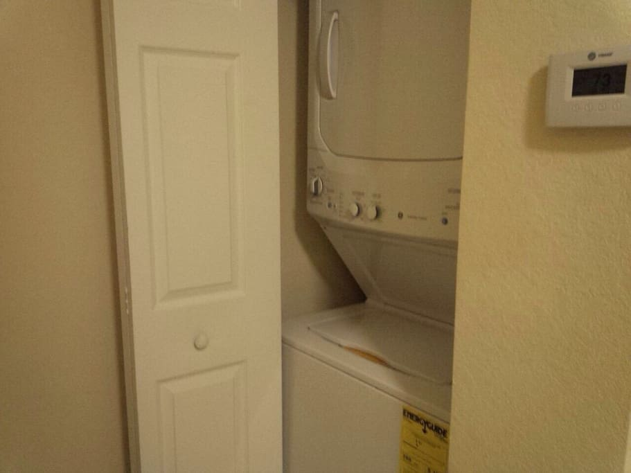 Inside laundry and dryer.
