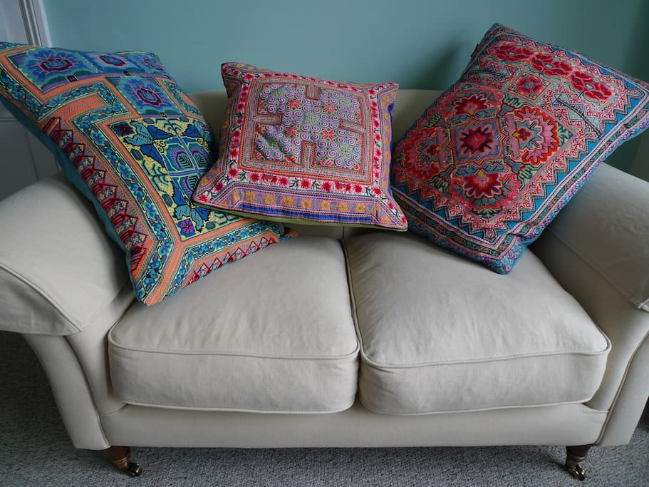 Lounge on the sofa complete with Sarah Bettridge Design cushions.