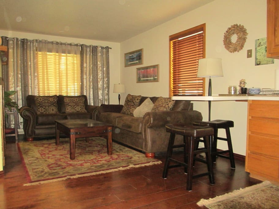 A comfortable living room offers a sony DVD player and Dish Network satellite programming.