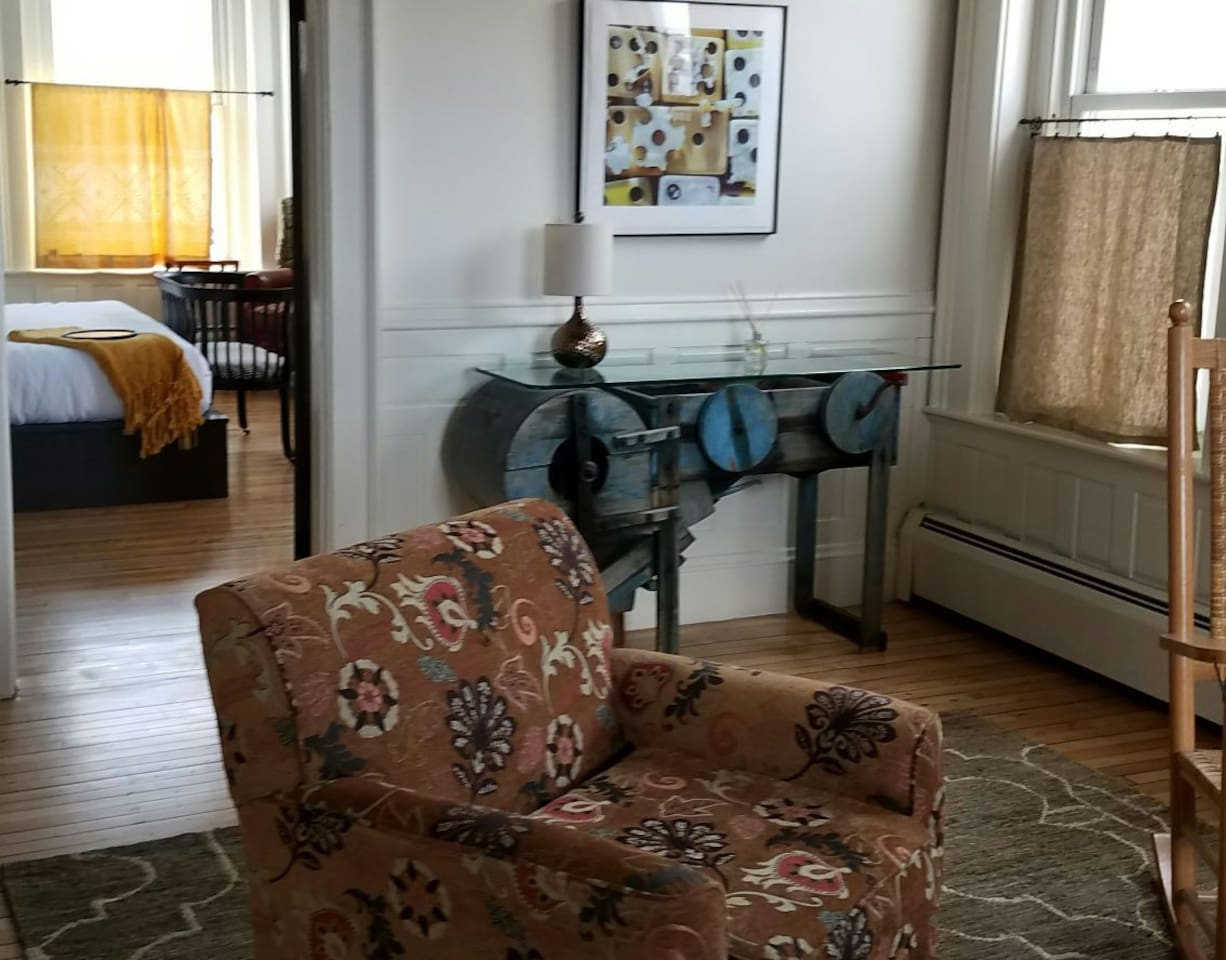 A spacious living room, Rosamond Purcell artwork and a view of the Mahoosucs.