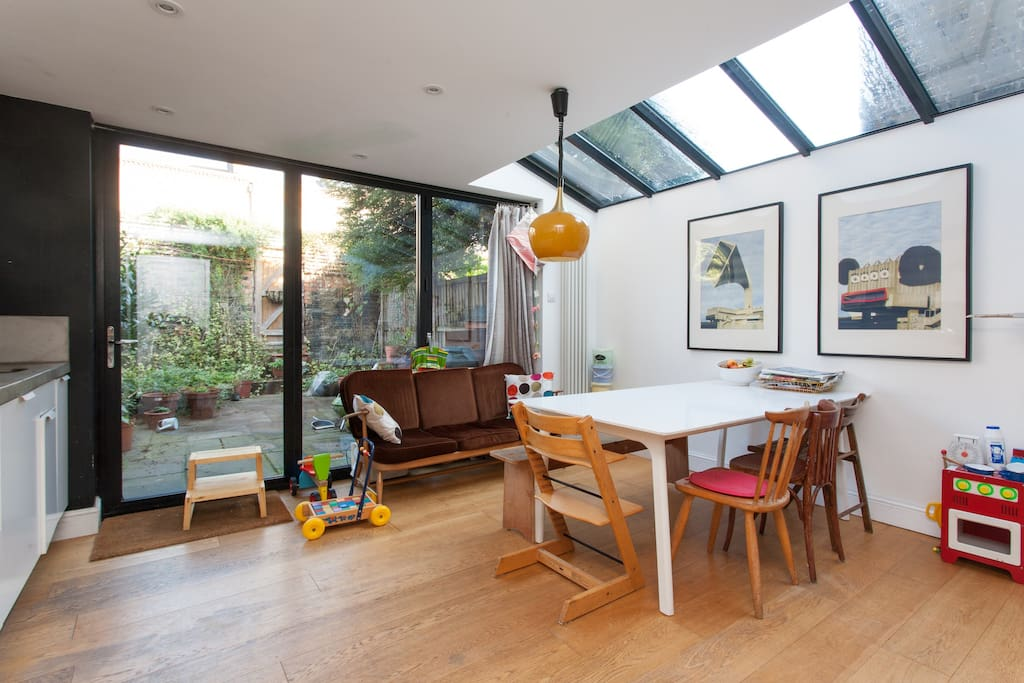 Glass roof in kitchen, large table, ercol sofa and children's toys