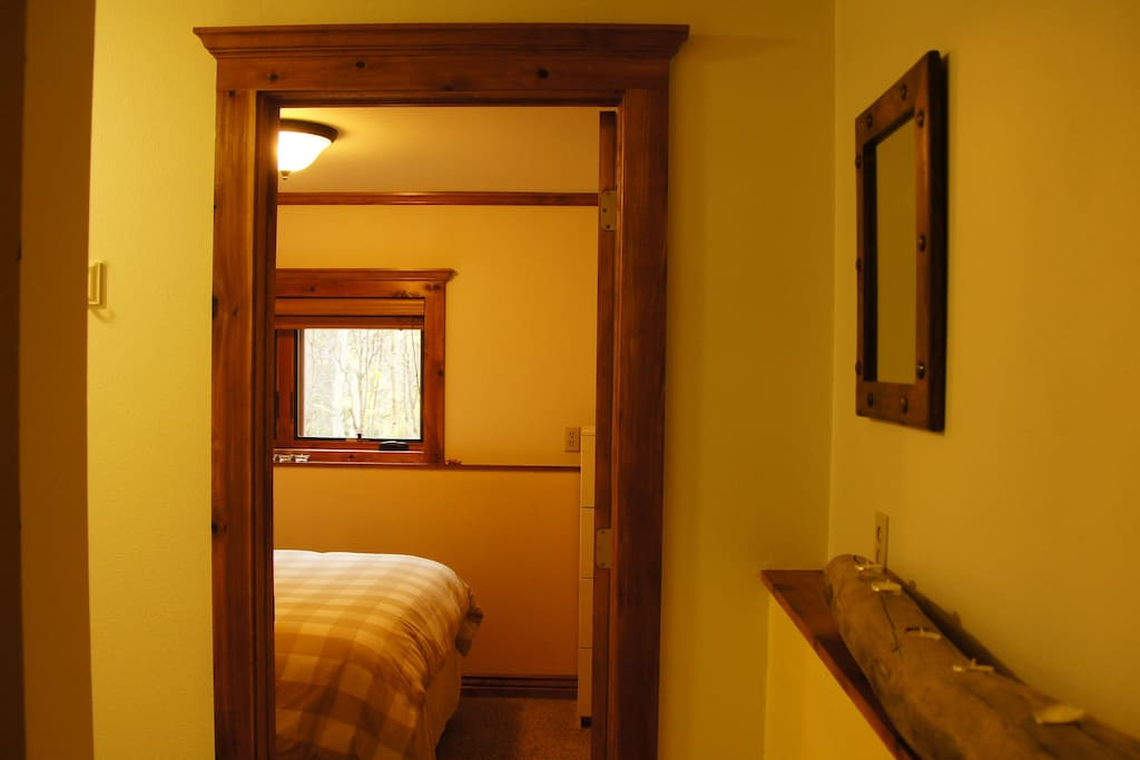 Leading into the second bedroom with mountain views