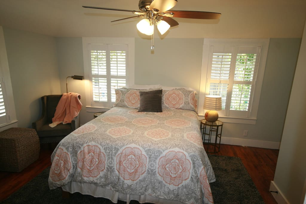 spacious and bright bedroom.  gorgeous, original 1940's hardwoods throughout, now, completely restored!