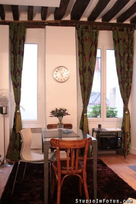 Dinner table, two large and high windows