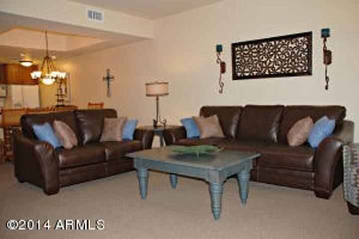 Great Room furniture with dining area and kitchen just beyond.