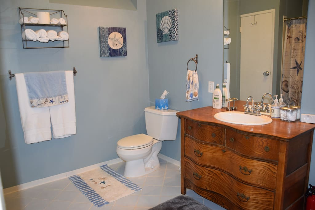 Large bathroom is stocked with everything you need during your stay - towels, toiletries (shampoo/conditioner/body wash/lotion), hair dryer, q-tips, cotton balls and makeup wipes. If you need anything else just ask!