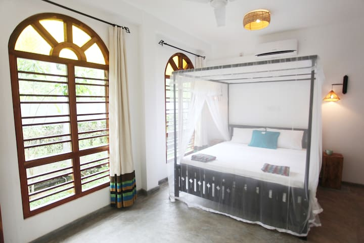 Spacious bedroom with large windows